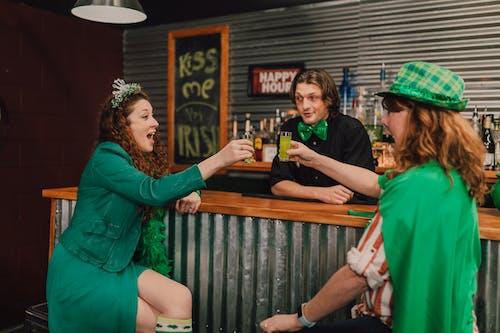 Two Women Celebrating Saint Patrick's Day at the Pub