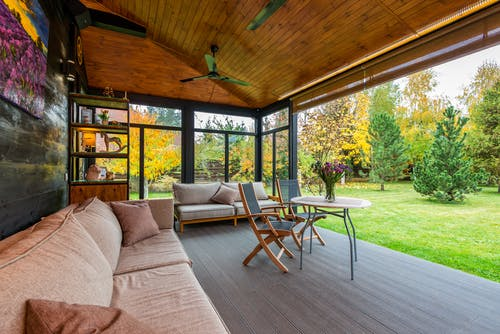 Terrace with comfortable couches and armchairs around table