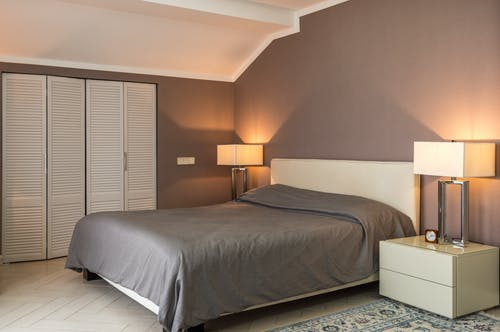 Bedroom interior with geometric lamps and ceiling