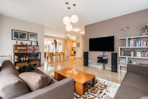 Spacious living room with sofa and TV