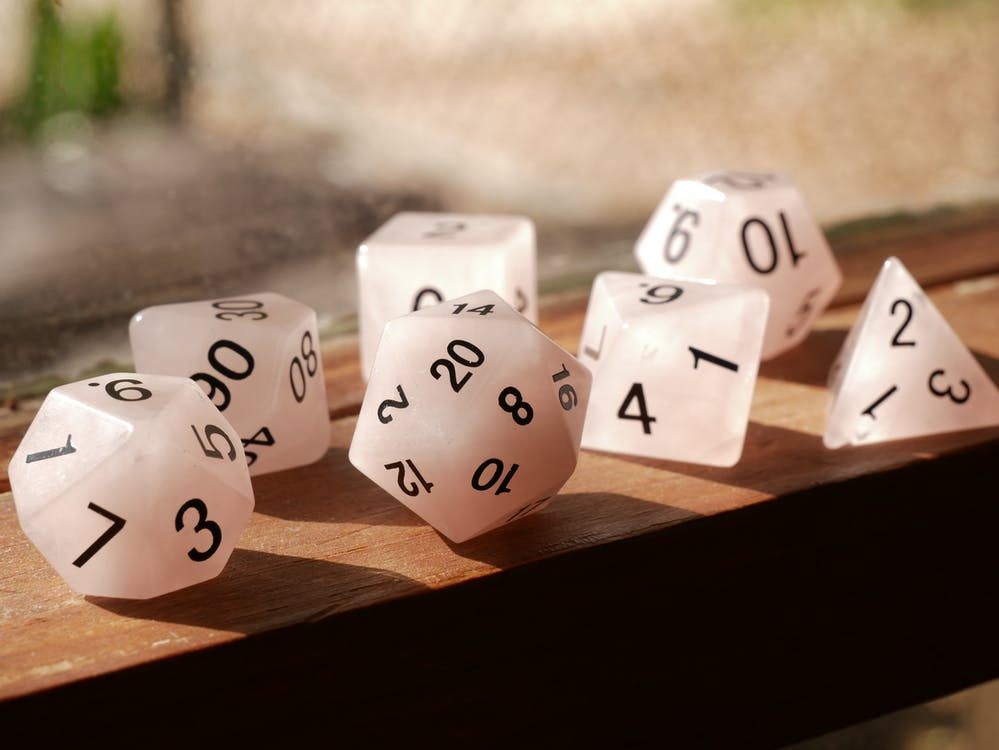 White Dices on Brown Wooden Table
