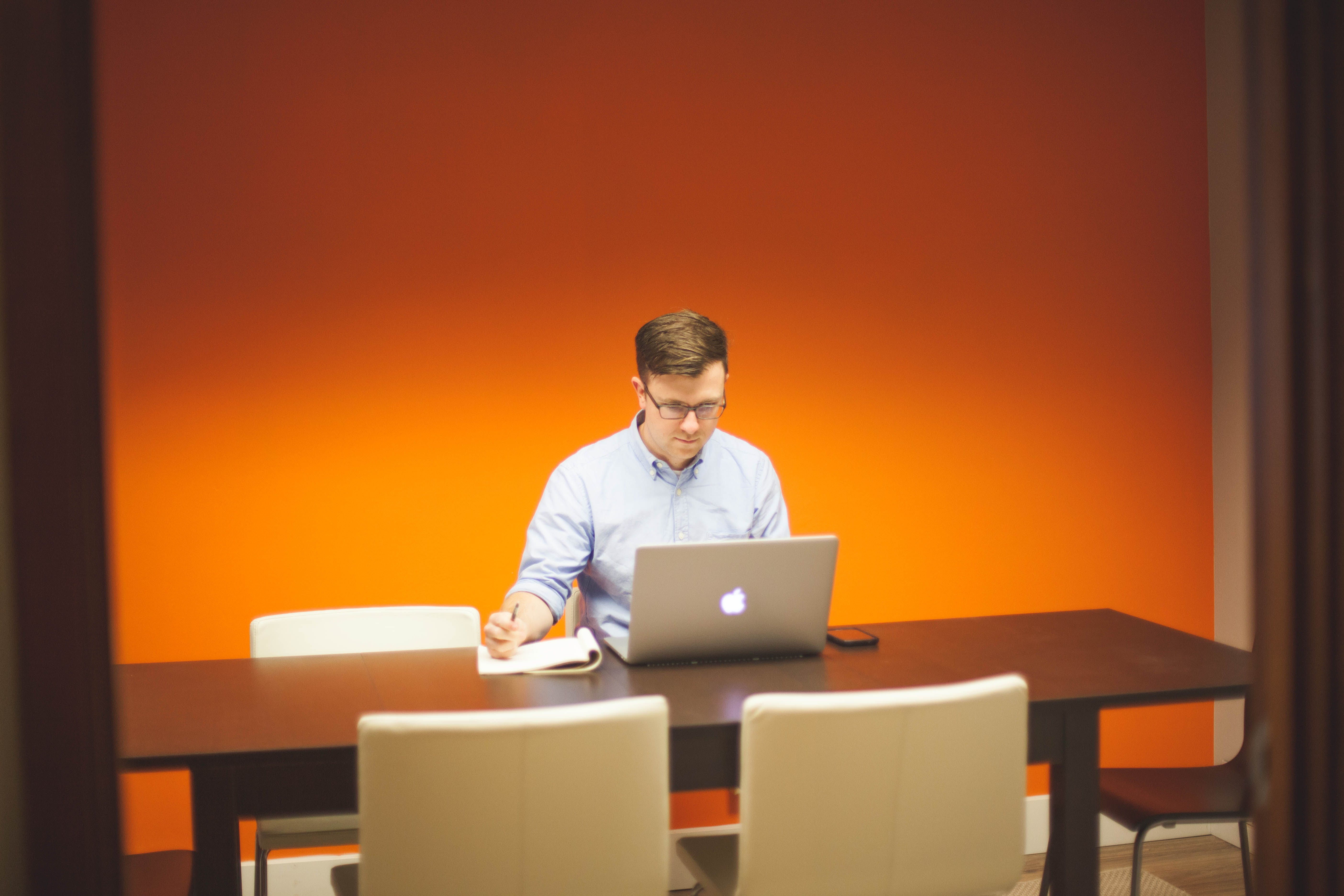 Free stock photo of man, person, apple, desk