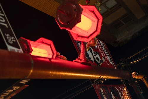 Signpost with decorative lanterns in evening town