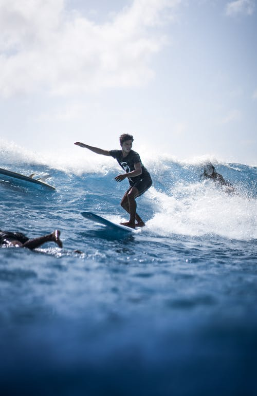 Woman riding surfboard in sea