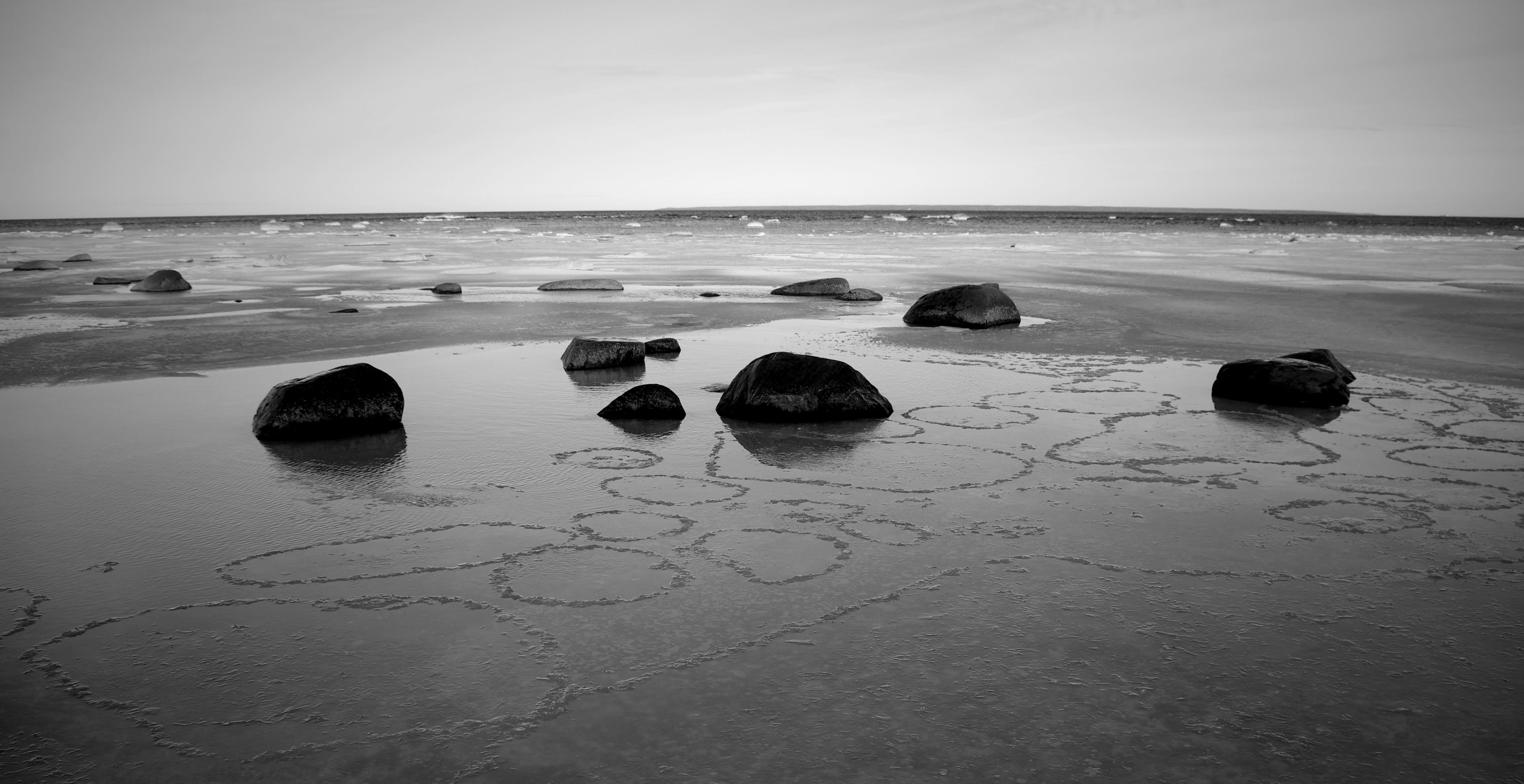 Grayscale Concrete Stones on Sand
