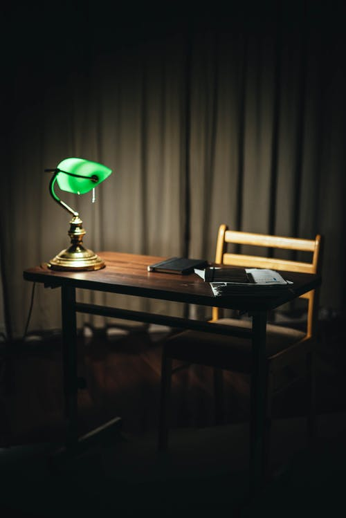 Table with lamp and documents