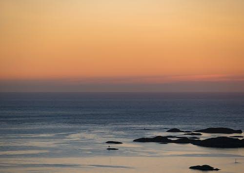 Бесплатное стоковое фото с апельсин, Арктический, горизонт, закат