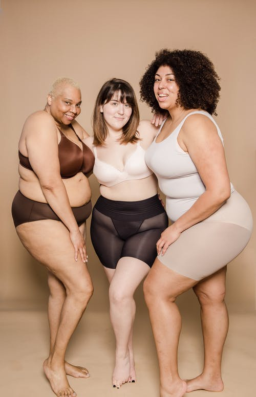Positive multiracial overweight women in lingerie