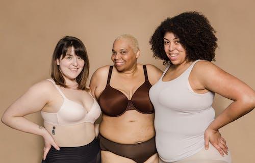 Happy diverse plump women in lingerie