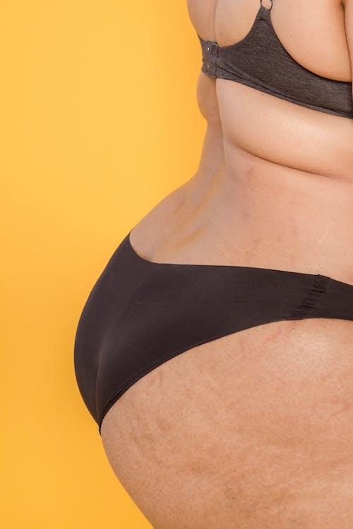 Unrecognizable overweight model in black lingerie