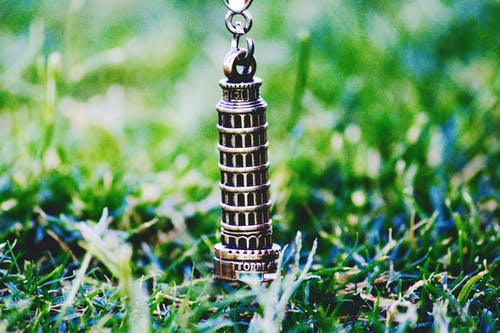 Leaning Tower of Pisa Pendant on Green Grass at Daytime