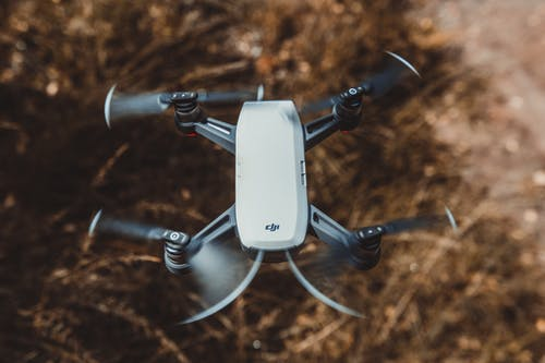 Selective Focus Photography of White and Black Quad Copter