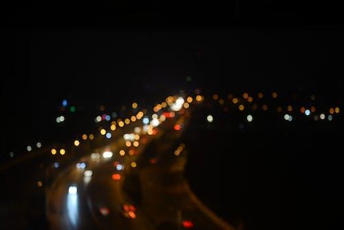 Gratis lagerfoto af aften, belyst, bevægelse, biler