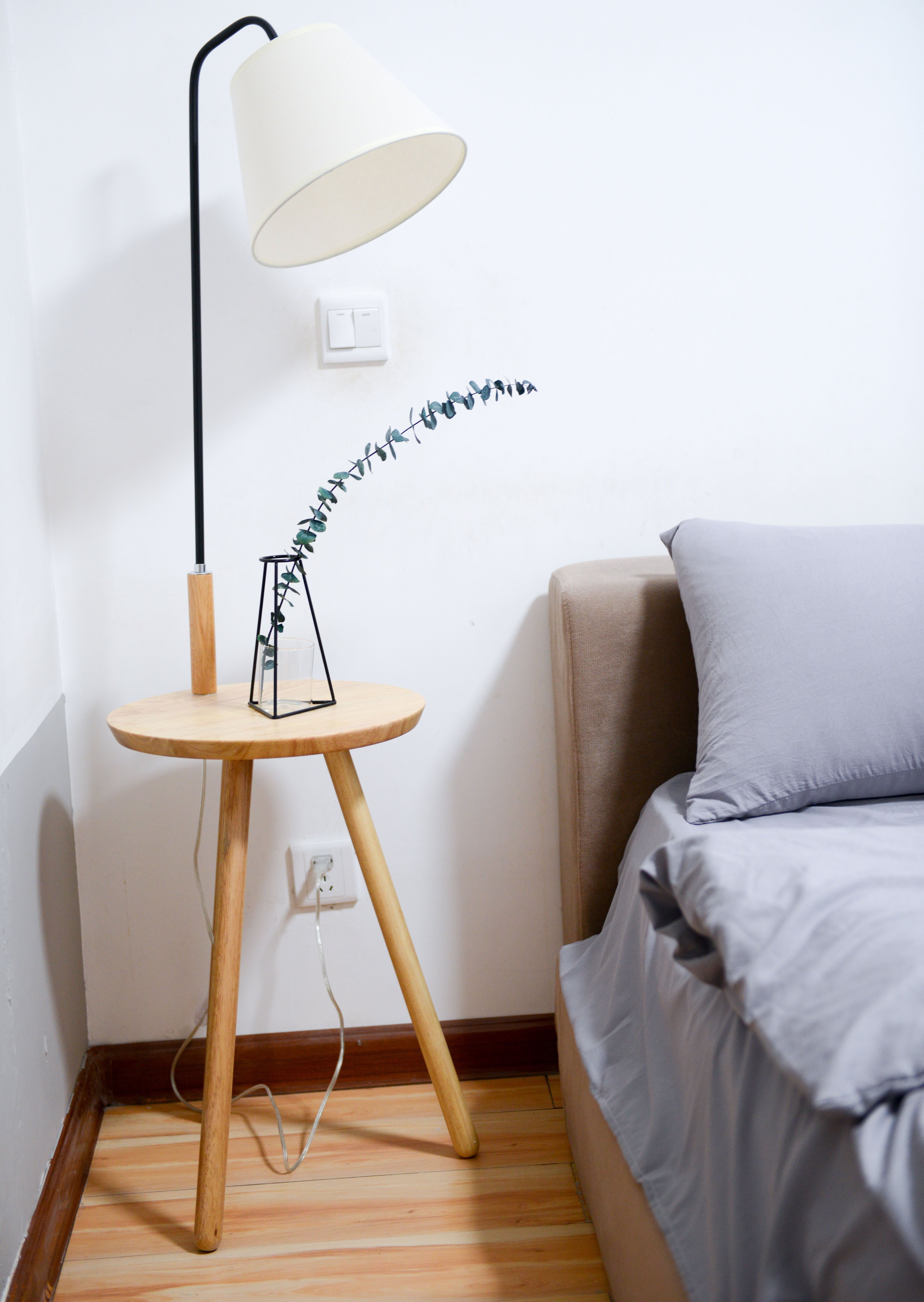 White Shade Table Lamp Near Bed
