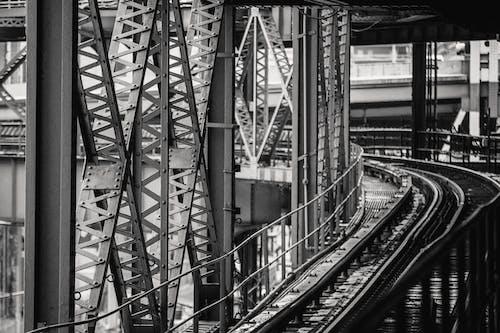 Metal constructions of modern bridge over river in city