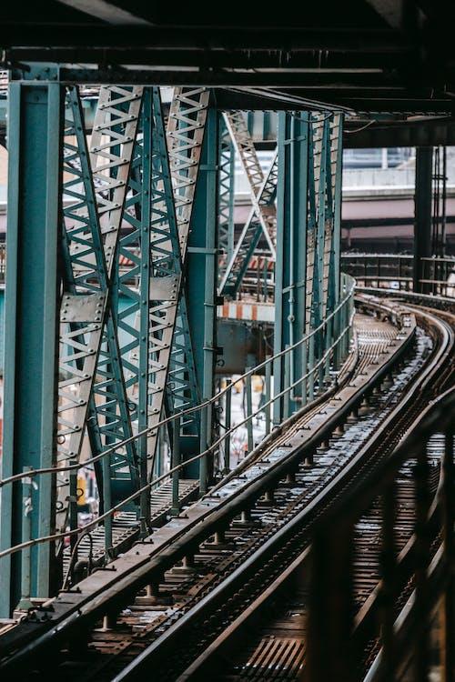 Massive metal constructions and railroad on modern Manhattan Bridge crossing river in New York City