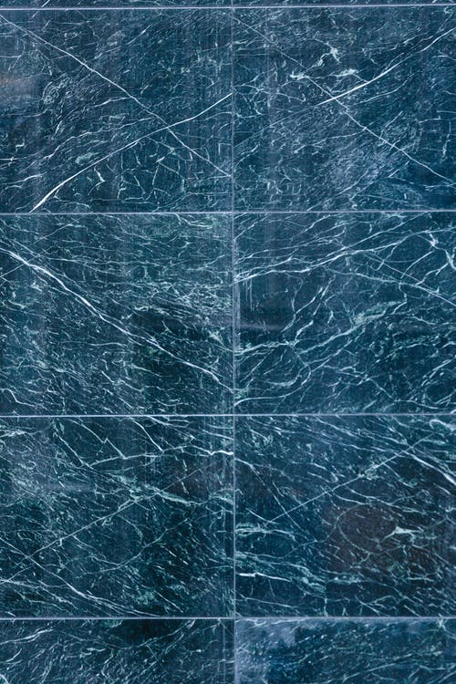 Top view of marble tile with scratches and white lines on street of town