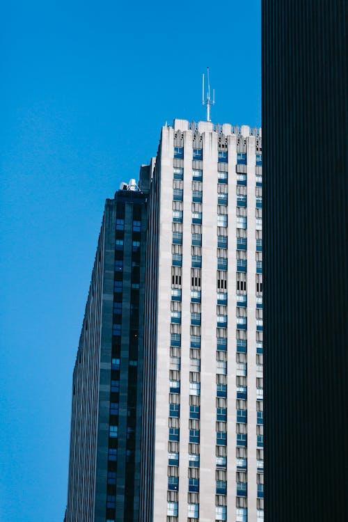 Modern tall building of gray business center