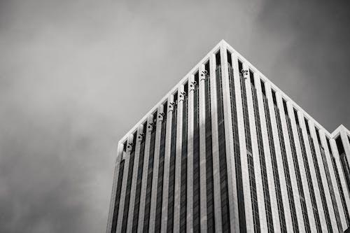 Corner of tall financial skyscraper in megalopolis
