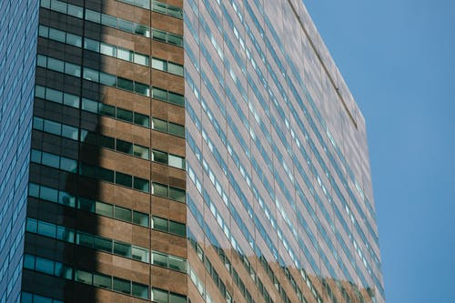 High rise business building with smooth glass walls