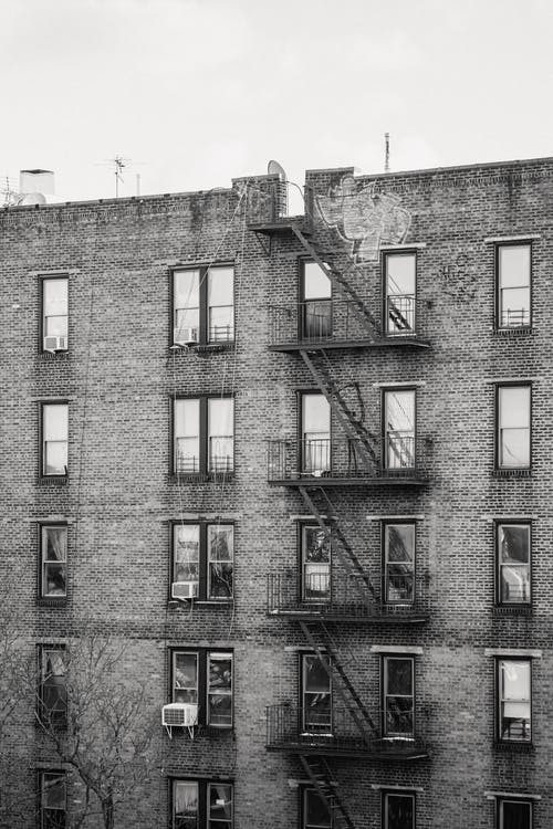 Aged building with metal fire escapes
