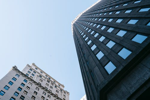 Facade of multistory buildings against cloudless sky on daylight