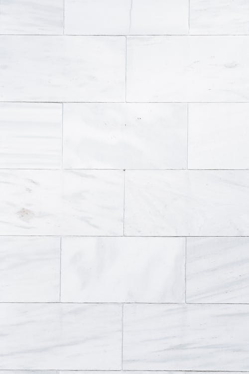 Full frame architecture and home interior textured background of white marble tiled wall pattern