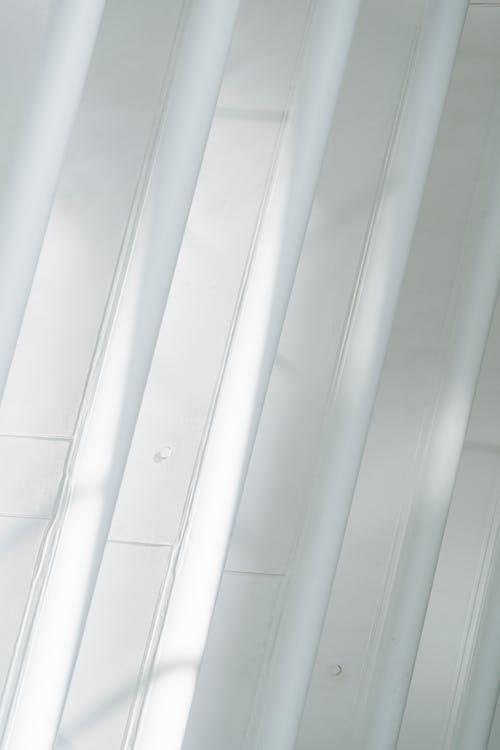 Unusual white geometric wall with windows in minimalist building