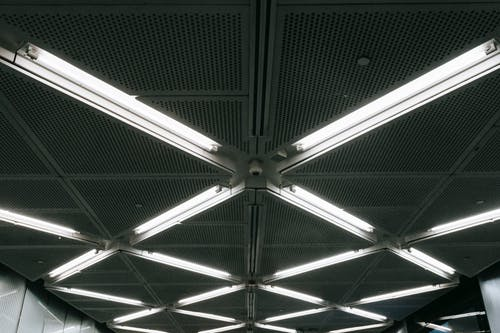 Metal ceiling with glowing lamps in underground garage