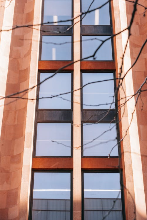 Facade of contemporary multistage building with mirrored windows