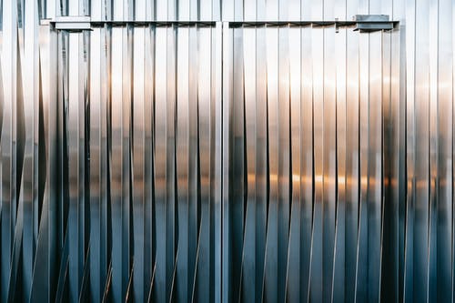 Closed metal gates with uneven surface