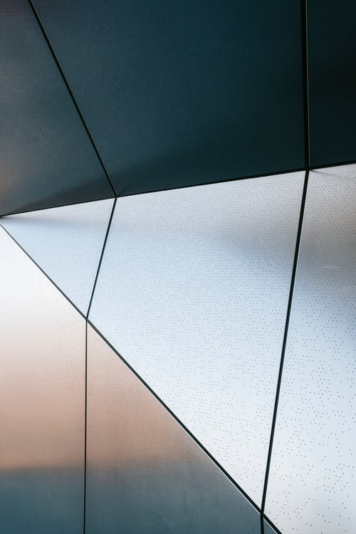 Full frame of abstract geometric background of steel wall with straight lines and angles