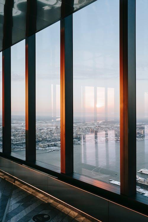 Panoramic window of multistory building on bay coast