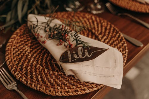 Personalized napkins on wicker coaster