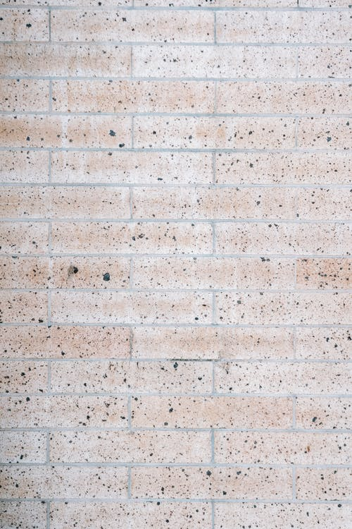 Brick wall with black dots on building