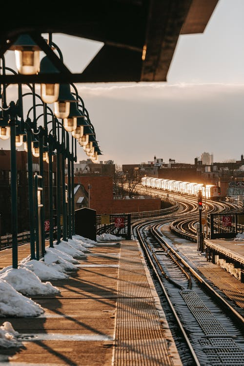 Train riding on railroad in winter day