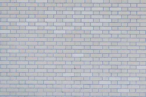 Gray wall with rows of bricks