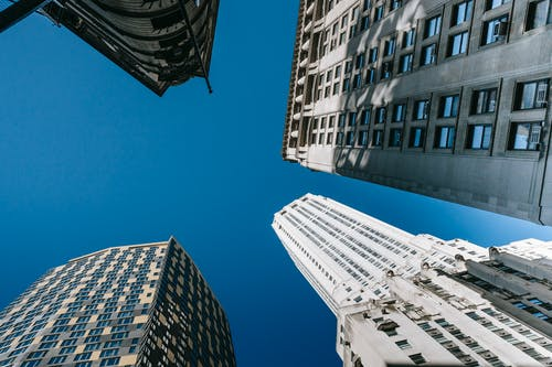 Modern multistory skyscrapers in megapolis under cloudless sky