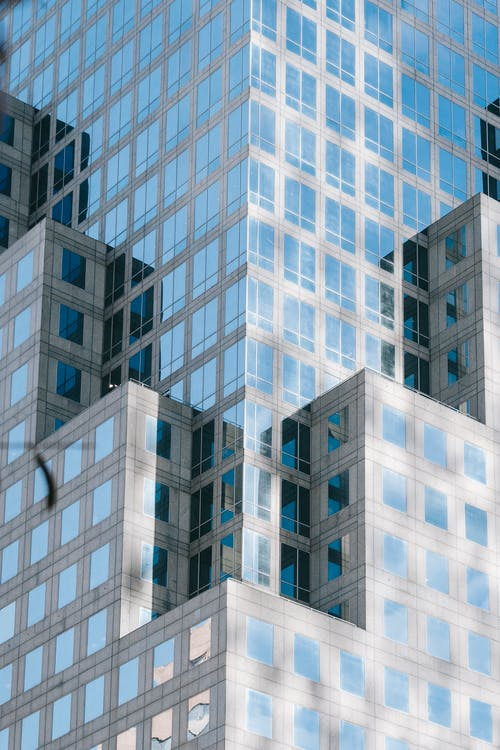 Low angle of modern multistage office complex with unusual geometric design located in downtown