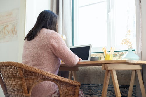 A Woman Working at Home with a Laptop