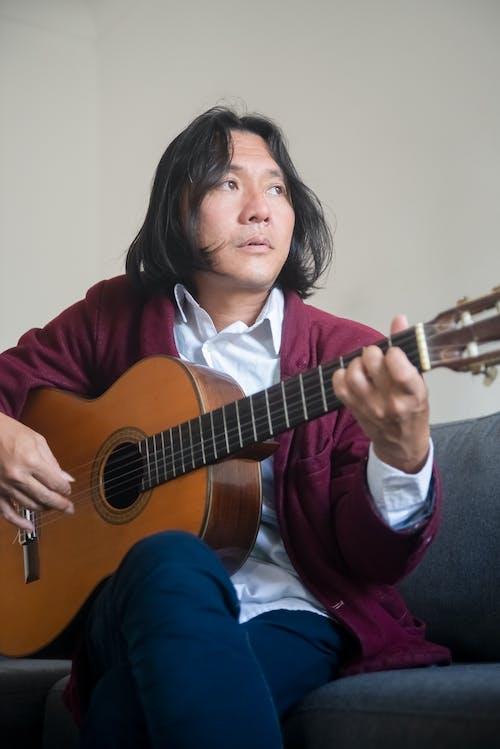 A Musician Playing a Guitar