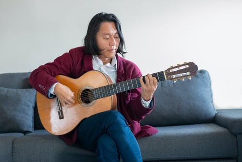 A Man Playing an Acoustic Guitar