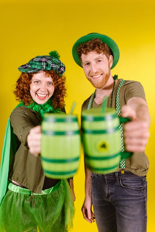 A Couple Holding Mugs
