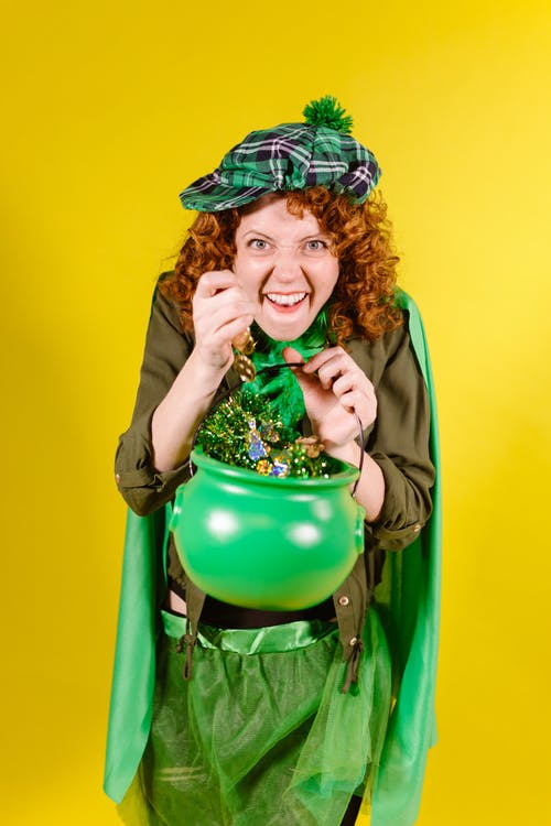 A Woman Holding a Pot of Gold