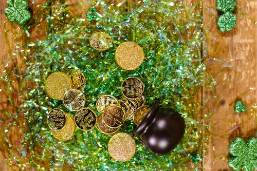 Gold Round Coins on Green Surface