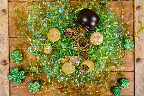 Silver Round Coins on Green and Brown Surface