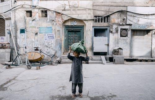 Woman in Gray Coat Holding Umbrella Walking on Sidewalk