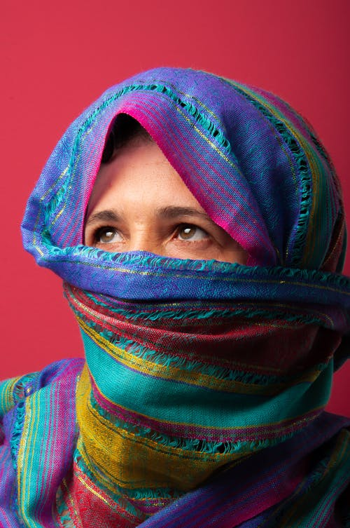 Woman in Blue and Purple Hijab
