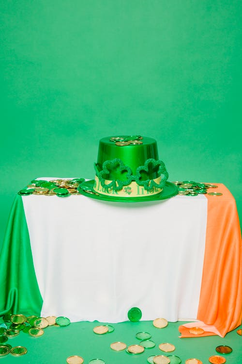 Festive hat with coins on flag