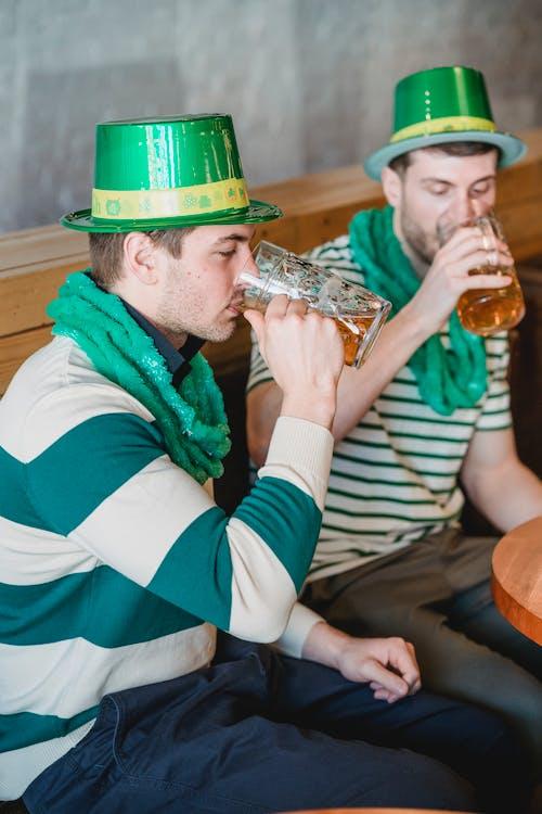 Friends drinking beer on Saint Patricks Day in pub